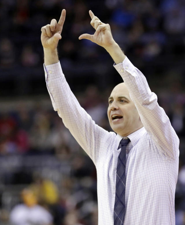 Utah State's head coach Craig Smith gives a sign to players in the first half against Washington during a first round men's college basketball game in the NCAA Tournament in Columbus, Ohio, Friday, March 22, 2019. (AP Photo/Tony Dejak)
