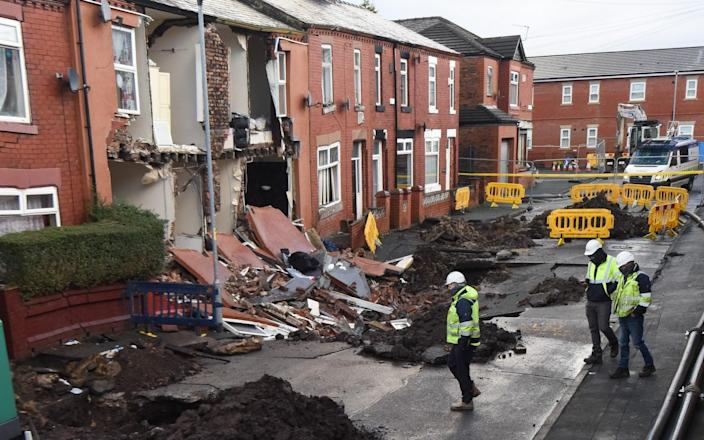 Manchester: Houses this morning on Walmer Street in Abbey Hey, Manchester. They fell into a giant sinkhole yesterday following heavy rainfall - Mercury Press