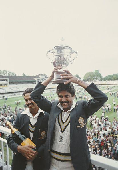 Skipper Kapil Dev jubilantly holds aloft the Prudential World Cup 1983 trophy as man-of-the-match Mohinder Amarnath revels in the moment.