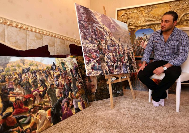 Ammar Salim poses next to some of his art pieces at his workshop in the Iraqi Kurdish city of Dohuk