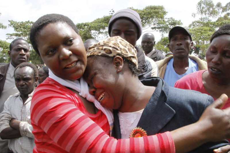 A Kenyan woman cries after looking at the wreckage of a police helicopter, that crashed in Ngong Forest, on the outskirts of Nairobi, Kenya, Sunday, June 10, 2012. Kenyan police said cabinet minister George Saitoti, who once served as Kenya's vice president, was one of seven people killed in the helicopter crash on the outskirts of Nairobi. (AP Photo/Khalil Senosi)