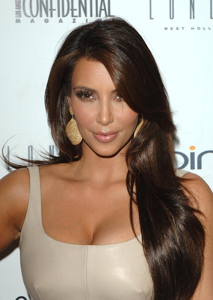 <p>Kardashian's glossy brown waves looked stunning at an event in 2010.</p>