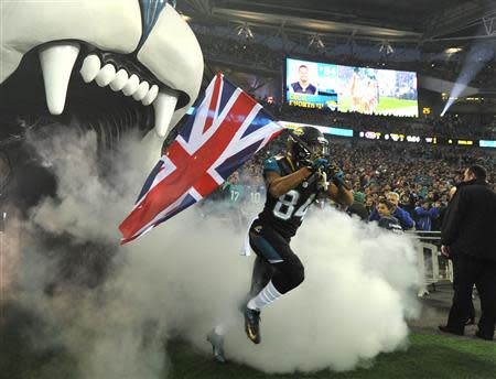 Jacksonville Jaguars wide receiver Shorts carries Britain's Union Jack as he enters the field before the Jaguars met the San Francisco 49ers during their NFL football game at Wembley Stadium in London