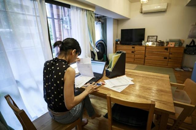 Yoshie Midorikawa is one of Japan's growing number of people who work from home. (AFP Photo/Behrouz MEHRI)