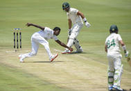 Sri Lanka's Vishwa Fernando catches the ball of his own bowling, on day two of the first cricket test match between South Africa and Sri Lanka at Super Sport Park Stadium in Pretoria, South Africa, Sunday, Dec. 27, 2020. (AP Photo/Catherine Kotze)