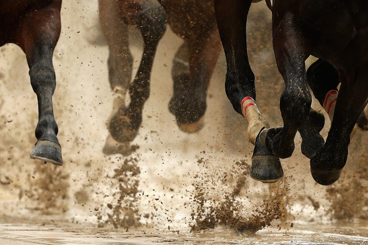 <p>Horses race on a sloppy track prior to the 143rd running of the Kentucky Derby at Churchill Downs on May 6, 2017 in Louisville, Kentucky. (Photo: Patrick Smith/Getty Images) </p>