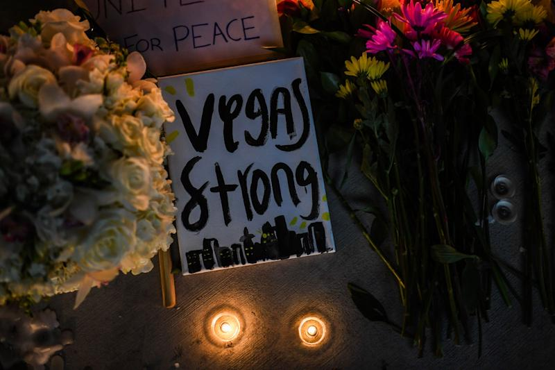 Flowers and signs are seen at a vigil that was held for the victims along the Las Vegas Strip a day after 59 people were killed and more than 500 wounded at the Route 91 Harvest Country Music Festival onOct. 2.