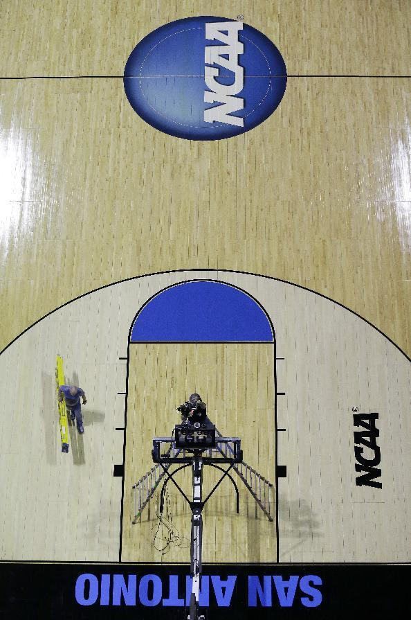 Workers prepare for the NCAA college basketball tournament games, Wednesday, March 19, 2014, in San Antonio. Play in San Antonio begins Friday when Nebraska faces Baylor. (AP Photo/Eric Gay)