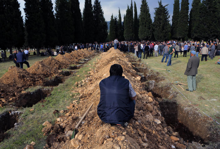 """<p> Rows of open graves for the mine accident victims are seen in Soma, Turkey, Wednesday, May 14, 2014. A violent protest erupted Wednesday in the Turkish city of Soma, where at least 238 coal miners have died after a mine explosion. Many in the crowd expressed anger at Prime Minister Recep Tayyip Erdogan's government. Rocks were being thrown and some people were shouting that Erdogan was a """"Murderer!"""" and a """"Thief!""""(AP Photo/Depo Photos) </p>"""