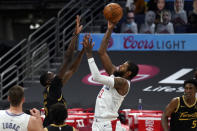 Los Angeles Clippers guard Paul George (13) shoots over Toronto Raptors forward Chris Boucher (25) during the second half of an NBA basketball game Tuesday, May 11, 2021, in Tampa, Fla. (AP Photo/Chris O'Meara)