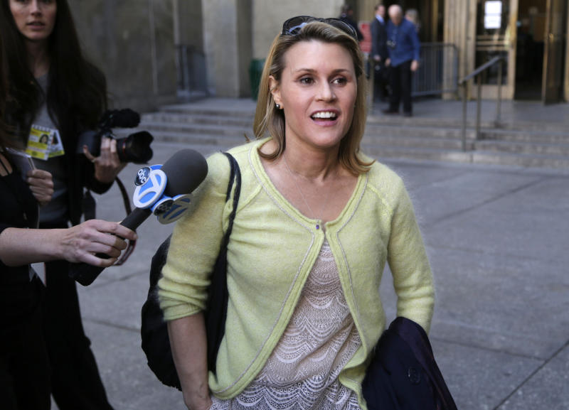 Genevieve Sabourin leaves court in New York, Monday, April 8, 2013.  Negotiations for a possible plea deal in New York for Sabourin, who is accused of stalking Alec Baldwin, broke down and her trial will begin in May. Police originally arrested Sabourin after authorities said she had implored Baldwin to see and to marry her in emails sent only days after he became engaged to yoga instructor Hilaria Thomas. She later spent a night in jail after she was accused of sending Thomas a Twitter message. (AP Photo/Seth Wenig)