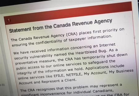 """The Canada Revenue Agency website is seen on a computer screen displaying information about an internet security vulnerability called the """"Heartbleed Bug"""" in Toronto"""