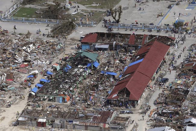 An aerial image taken from a Philippine Air Force helicopter shows the devastation caused by typhoon Haiyan in Guiuan, Eastern Samar province, central Philippines Monday, Nov. 11, 2013. Authorities said at least 2 million people in 41 provinces had been affected by Friday's disaster and at least 23,000 houses had been damaged or destroyed. (AP Photo/Bullit Marquez)