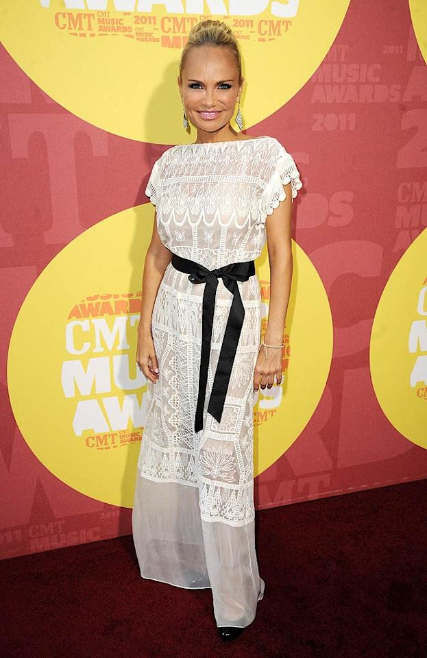 "Actress/singer Kristin Chenoweth, who is set to release a country album in the fall, showed off her petite figure in a sheer white dress pulled together with a black ribbon. Jeff Kravitz/<a href=""http://www.filmmagic.com/"" target=""new"">FilmMagic.com</a> - June 8, 2011"