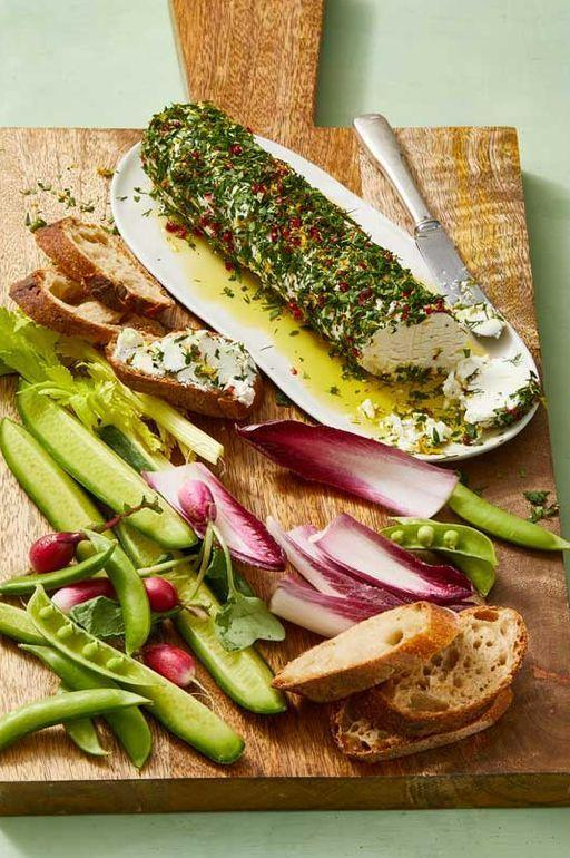 """<p>There's nothing like a lemon-herb goat cheese log to get the festivities rolling — especially when it's paired with the best of spring veggies. Serve this starter up with cucumber spears, snap peas, and endive leaves — and don't forget the crusty baguettes!</p><p><em><a href=""""https://www.goodhousekeeping.com/food-recipes/easy/a30655780/goat-cheese-appetizer-recipe/"""" target=""""_blank"""">Get the recipe for Goat Cheese Appetizer »</a> </em></p>"""