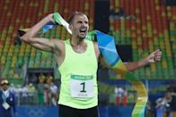 <p>Alexander Lesun of Russia celebrates as he crosses the finish line to win gold in the Modern Pentathlon on Day 15 of the Rio 2016 Olympic Games at Deodoro Stadium on August 20, 2016 in Rio de Janeiro, Brazil. (Photo by David Rogers/Getty Images) </p>