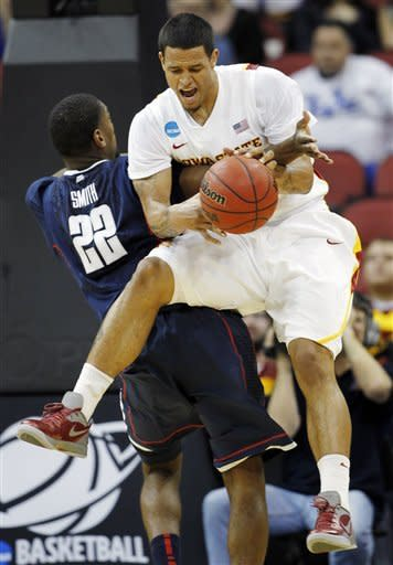 Iowa State guard Chris Babb (2) is fouled by Connecticut forward Roscoe Smith (22) in the first half of their NCAA tournament second-round college basketball game in Louisville, Ky., Thursday, March 15, 2012. (AP Photo/John Bazemore)