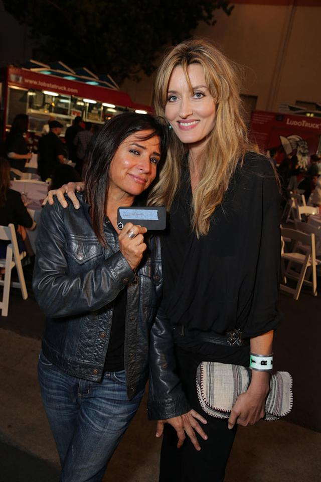 "Pamela Adlon and Natasha McElhone at the ""Californication"" Season 7 wrap party in Los Angeles, California on July 28, 2013."