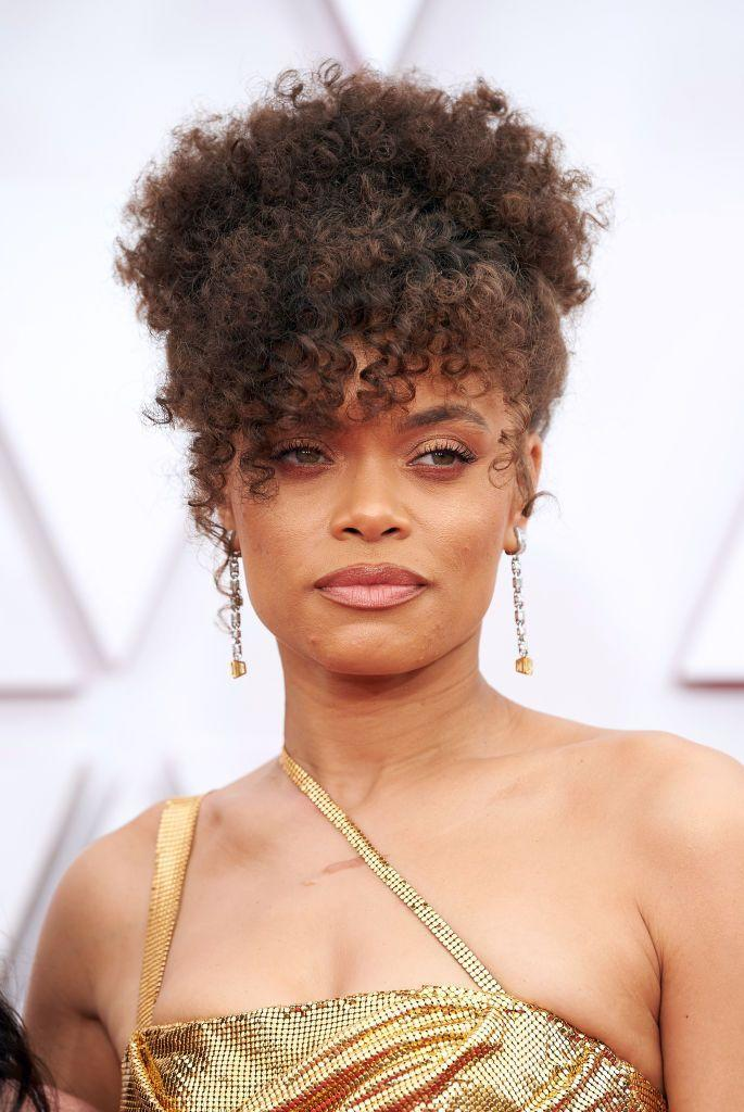<p>Andra Day matched her molten-gold Vera Wang gown with a similarly bronzed beauty look and a soft, curly updo.</p>