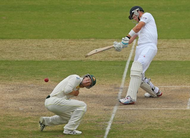 ADELAIDE, AUSTRALIA - DECEMBER 08: Joe Root of England plays a pull shot as George Bailey of Australia ducks during day four of the Second Ashes Test Match between Australia and England at Adelaide Oval on December 8, 2013 in Adelaide, Australia. (Photo by Scott Barbour/Getty Images)