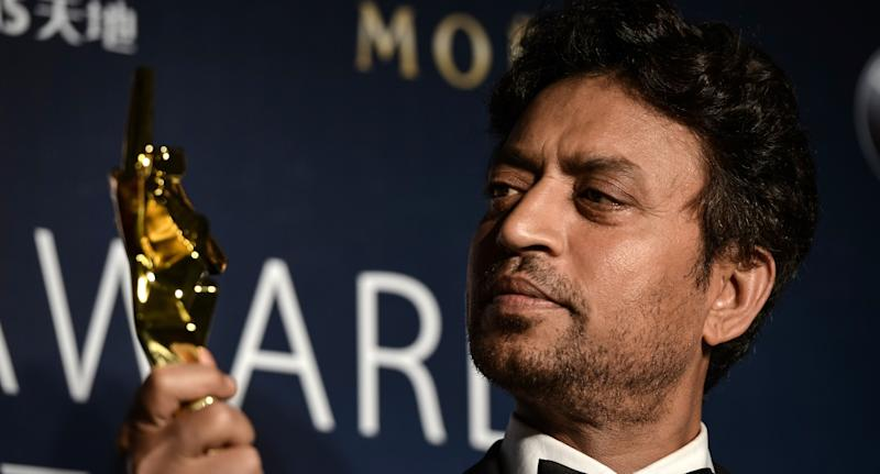 Best actor winner Irrfan Khan of India poses with his trophy during the Asian Film Awards in Macau on March 27, 2014. AFP PHOTO / Philippe Lopez (Photo credit should read PHILIPPE LOPEZ/AFP via Getty Images)