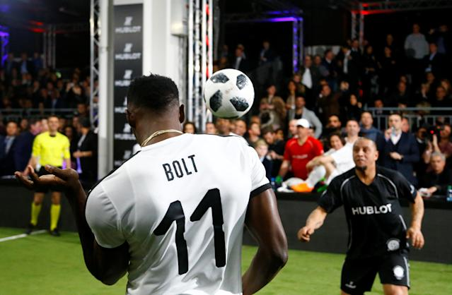 Soccer Football - Hublot Match of Friendship - Congress Center, Basel, Switzerland - March 21, 2018 Usain Bolt of Team Jose Mourinho in action with Roberto Carlos of Team Diego Maradona REUTERS/Arnd Wiegmann