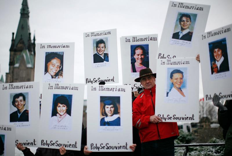 Demonstrators hold portraits of some of the women killed during the Polytechnique massacre. (Photo: Chris Wattie / Reuters)