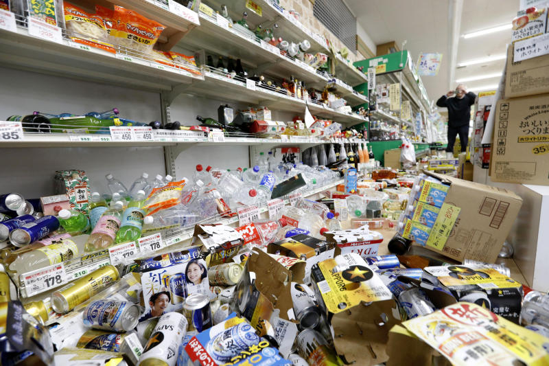 Cans and other items are scattered on the floor of a supermarket in Tsuruoka, Yamagata prefecture, northwestern Japan, Wednesday, June 19, 2019, after an earthquake. The powerful earthquake jolted northwestern Japan late Tuesday, prompting officials to issue a tsunami warning along the coast which was lifted about 2 ½ hours later.  (Hironori Asakawa/Kyodo News via AP)