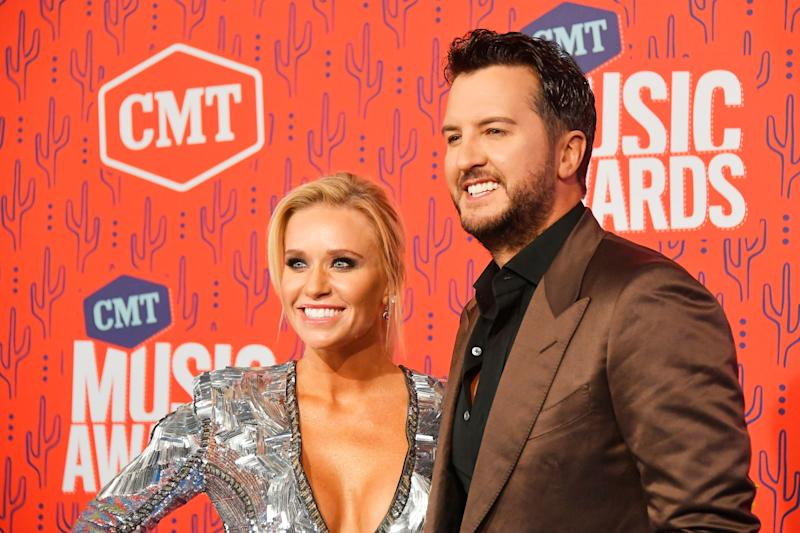 Caroline Bryan (Left) and Luke Bryan (Right) pose and smile at CMT Music Awards