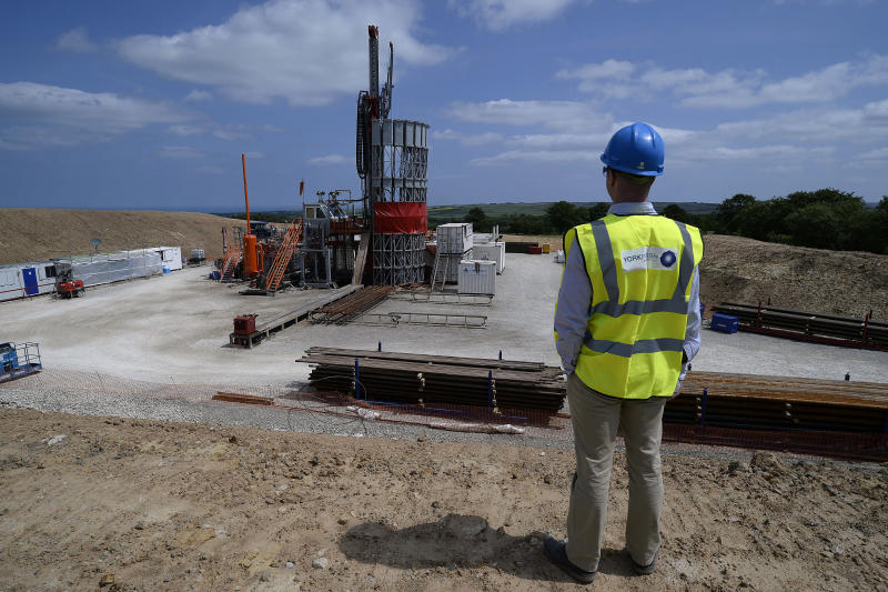 "An employee poses for a photograph at the Sirius Minerals test drilling station on the North Yorkshire Moors near Whitby, northern England July 5, 2013. Sirius Minerals, is planning one of the world's largest potash mines in response to booming global demand for the crop fertilizer, within the North York Moors National Park boundaries. ""There's a huge amount of paper work to deal with. Everyone's watching; there's pressure on both sides,"" operations director Graham Clarke told Reuters at the drill site near the coastal town of Whitby, where a large red rig pierces a clear summer sky. Photograph taken on July 5, 2013. REUTERS/Nigel Roddis (BRITAIN - Tags: BUSINESS ENERGY ENVIRONMENT)"