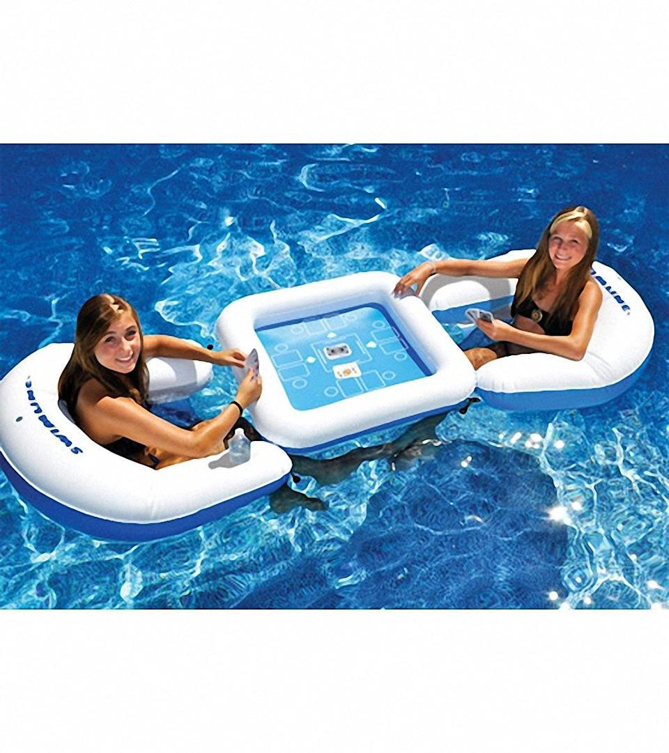 "<h3><a href=""https://www.swimoutlet.com/p/swimline-game-station-set-with-waterproof-playing-cards-7530653/"" rel=""nofollow noopener"" target=""_blank"" data-ylk=""slk:Swimline Game Station Set With Waterproof Playing Cards"" class=""link rapid-noclick-resp"">Swimline Game Station Set With Waterproof Playing Cards</a></h3> <br>Take your favorite card competition from table to pool — yes, <em>pool</em> — with this waterproof game station featuring inflatable sling seats, drink holders, a gloating table, and waterproof playing cards. You can even connect the chairs to the table so your opponent can't get away with floating away to avoid defeat. <br><br><br><strong>Swimline</strong> Game Station Set With Waterproof Playing Cards, $, available at <a href=""https://go.skimresources.com/?id=30283X879131&url=https%3A%2F%2Fwww.swimoutlet.com%2Fp%2Fswimline-game-station-set-with-waterproof-playing-cards-7530653%2F"" rel=""nofollow noopener"" target=""_blank"" data-ylk=""slk:Swim Outlet"" class=""link rapid-noclick-resp"">Swim Outlet</a><br><br>"