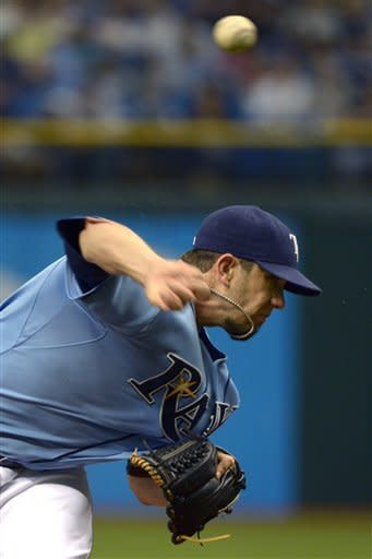 Tampa Bay Rays starting pitcher James Shields throws to home plate during the first inning of a baseball game against the Texas Rangers in St. Petersburg, Fla., Sunday, Sept. 9, 2012. (AP Photo/Phelan M. Ebenhack)