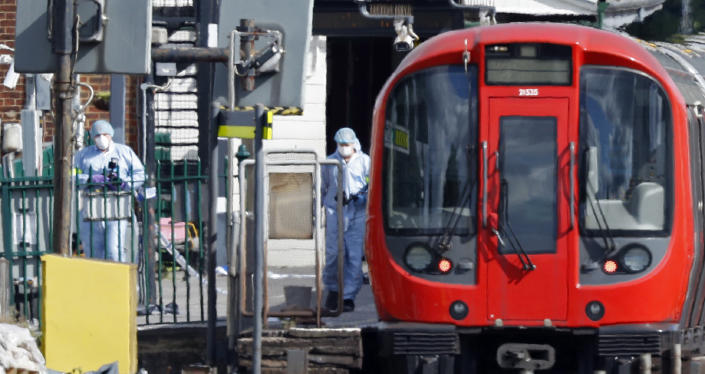 <p>Police forensics officers works alongside an underground tube train at a platform at Parsons Green underground tube station in west London on September 15, 2017, following an incident on an underground tube carriage at the station. (Photo: Adrian Dennis/AFP/Getty Images) </p>