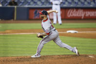 Washington Nationals relief pitcher Justin Miller (60) delivers a pitch during the eighth inning of a baseball game against the Miami Marlins on Thursday, June 24, 2021, in Miami. (AP Photo/Mary Holt)
