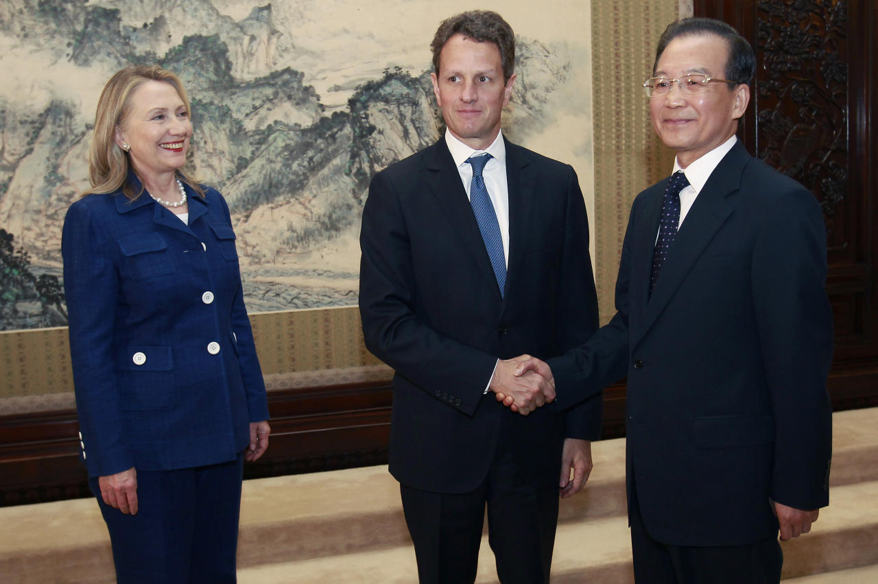 BEIJING, CHINA - MAY 3: U.S. Secretary of State Hillary Clinton (L) looks on as Treasury Secretary Timothy Geithner (2nd L) shakes hands with China's Premier Wen Jiabao during a meeting at the Zhongnanhai leadership compound on May 4, 2012 in Beijing. Hillary Clinton is in China for bilateral talks and has called on China to protect human rights. Chinese activist Chen Guangcheng has aksed to meet with the U.S Secretary of State to discuss his situation.  (Photo by Shannon Stapleton/Pool/Getty Images)