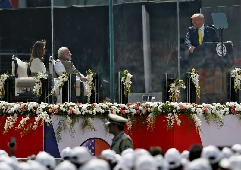 "U.S. President Donald Trump addresses the audience as Indian Prime Minister Narendra Modi and U.S. first lady Melania Trump watch during the ""Namaste Trump"" event at Sardar Patel Gujarat Stadium, in Ahmedabad"