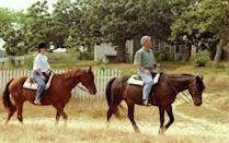 <p>Bill Clinton and his daughter, Chelsea, ride horses along a trail in Martha's Vineyard, Massachusetts during a family vacation.<br></p><p>Other celebrity visitors this year: Jackie Onassis, Mike Wallace, Spike Lee, Beverly Sills, James Taylor, Walter Cronkite.</p>