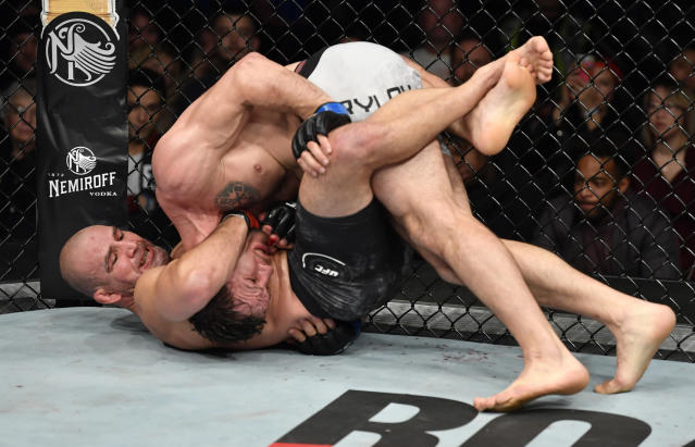 (L-R) Glover Teixeira attempts a guillotine choke submission against Nikita Krylov in their light heavyweight bout during the UFC Fight Night event at Rogers Arena on Sept. 14, 2019 in Vancouver, Canada. (Jeff Bottari/Zuffa LLC)