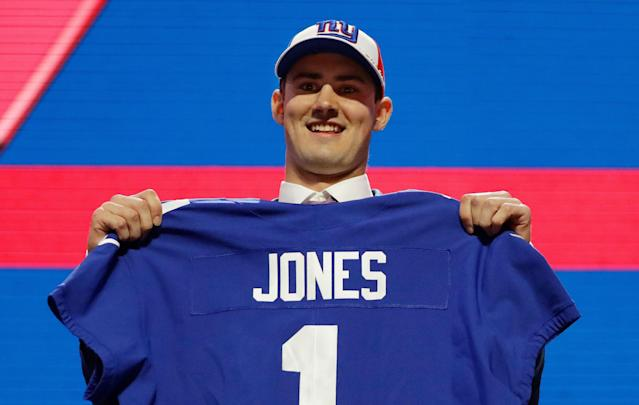 Duke quarterback Daniel Jones poses with his new jersey after the New York Giants selected Jones in the first round at the NFL football draft, Thursday, April 25, 2019, in Nashville, Tenn. (AP)