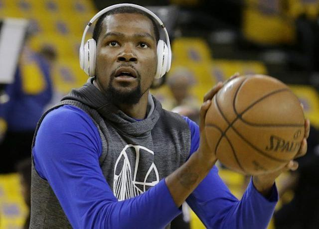 "<a class=""link rapid-noclick-resp"" href=""/nba/players/4244/"" data-ylk=""slk:Kevin Durant"">Kevin Durant</a> chooses the noise he wants to hear. (AP)"