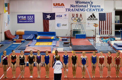 "FILE - In this May 2008 file photo, gymnasts including Nastia Liukin, far left, and Shawn Johnson, far right, line up for Martha Karolyi during USA Gymnastics National Team training at the Karolyi Ranch, in Huntsville, Texas. Former USA Gymnastics women's national team coordinator Martha Karolyi and her husband Bela tell NBC they were unaware of the abusive behavior by a former national team doctor now serving decades in prison. Martha Karolyi led the national team for 15 years before retiring after the 2016 Rio Olympics. She tells Savannah Guthrie in ""no way"" did she suspect Larry Nassar was sexually abusing athletes. (Smiley N. Pool/Houston Chronicle via AP, File)"