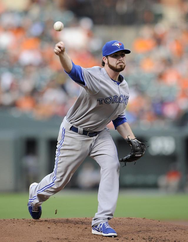 Toronto Blue Jays starting pitcher Drew Hutchison delivers against the Baltimore Orioles during the first inning of a baseball game on Friday, June 13, 2014, in Baltimore. (AP Photo/Nick Wass)