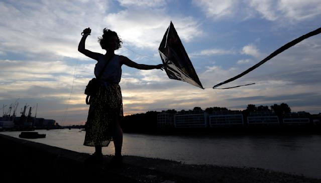 <p>Artist Gabriela Hirst flies a kite for an art installation called 'Preliminary Attempts to Rearrange a Sunset', a shifting installation in the sky on the bank of the River Thames in London, Thursday, Aug. 23, 2018. (AP Photo/Kirsty Wigglesworth) </p>