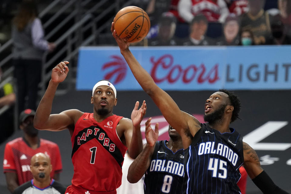 Orlando Magic forward Donta Hall (45) steals a pass intended for Toronto Raptors guard Paul Watson Jr., (1) during the second half of an NBA basketball game Friday, April 16, 2021, in Tampa, Fla. (AP Photo/Chris O'Meara)