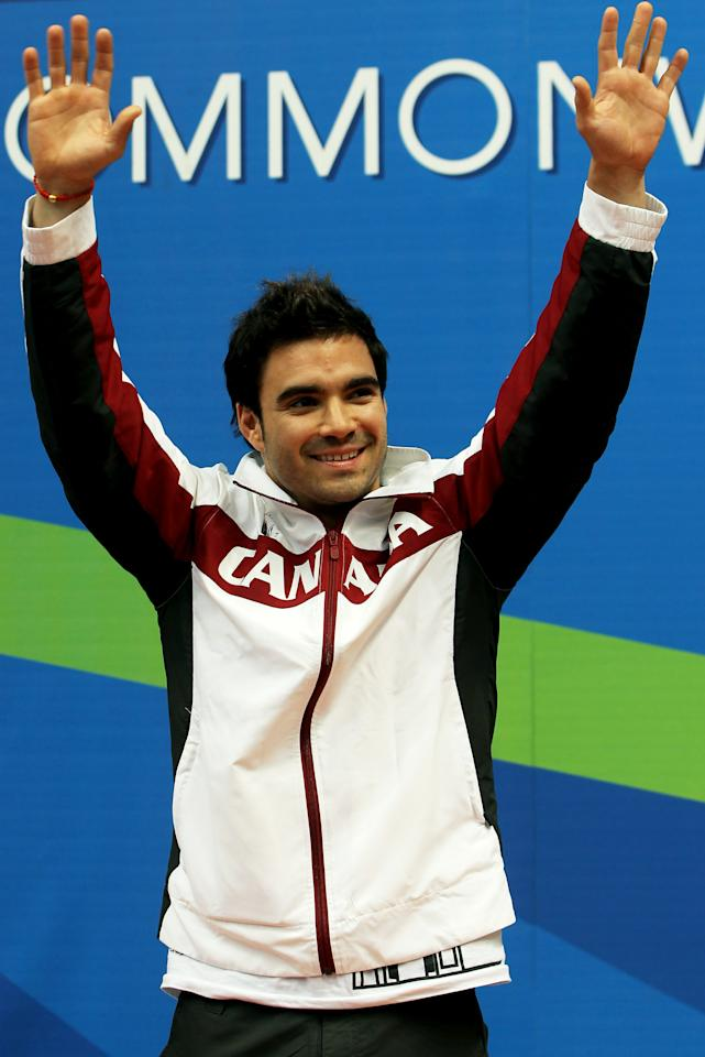 DELHI, INDIA - OCTOBER 11:  Alexandre Despatie of Canada celebrates prior to receiving the gold medal won in the Men's 3m Springboard Final at Dr. S.P. Mukherjee Aquatics Complex during day eight of the Delhi 2010 Commonwealth Games on October 11, 2010 in Delhi, India.  (Photo by Phil Walter/Getty Images)