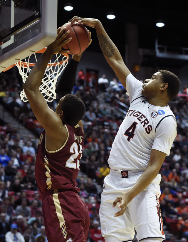 Auburn forward Chuma Okeke (4) blocks a shot and fouls Charleston forward Nick Harris (23) during the first half of a first-round NCAA college basketball tournament game Friday, March 16, 2018, in San Diego. (AP Photo/Denis Poroy)
