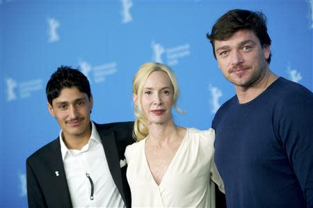 "Cast member Mohsin Ahmady, director, producer and screenwriter Feo Aladag and German actor Ronald Zehrfeld (L-R) pose during a photocall to promote the movie ""Zwischen Welten"" (Inbetween Worlds) during the 64th Berlinale International Film Festival in Berlin February 11, 2014. REUTERS/Stefanie Loos"