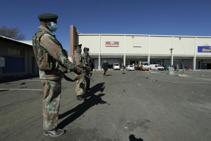 Soldiers patrol at a shopping centre in Soweto, Johannesburg Tuesday July 13, 2021. South Africa's rioting continued Tuesday with the death toll rising to 32 as police and the military struggle to quell the violence in Gauteng and KwaZulu-Natal provinces. The violence started in various parts of KwaZulu-Natal last week when Zuma began serving a 15-month sentence for contempt of court. (AP Photo/Themba Hadebe)