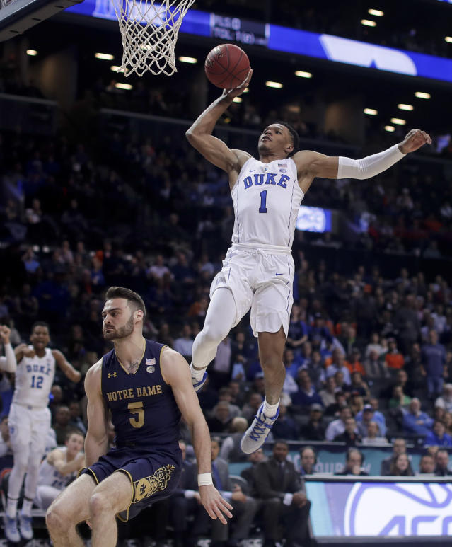 Duke guard Trevon Duval (1) goes up to dunk against Notre Dame guard Matt Farrell (5) during the second half during the first half of an NCAA college basketball game in the Atlantic Coast Conference men's tournament Thursday, March 8, 2018, in New York. (AP Photo/Julie Jacobson)