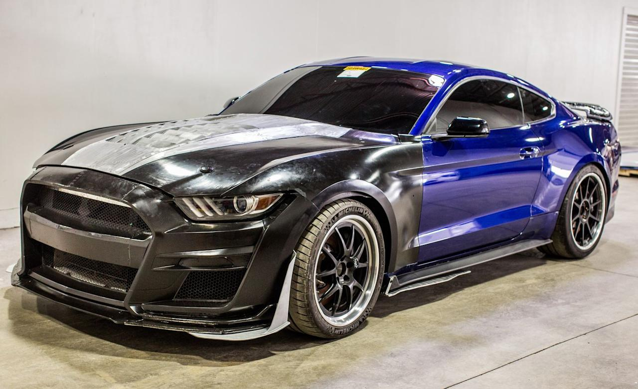 "<p>At top speed, the GT4-borrowed airfoil of the Exposed Carbon Fiber Track package contributes to a net downforce of 440 pounds. The Handling package–equipped GT500s, with a Gurney flap attached to its hybrid spoiler-cum-wing ""swing,"" develops about 220 pounds of total downforce. The base GT500 gets by with no downforce-aiding elements but the prize of being the quickest GT500 in a straight line, says Ford.</p>"